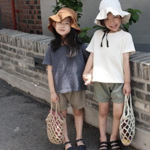 韓国子供服オープニングアンドのワッフル生地トップスです